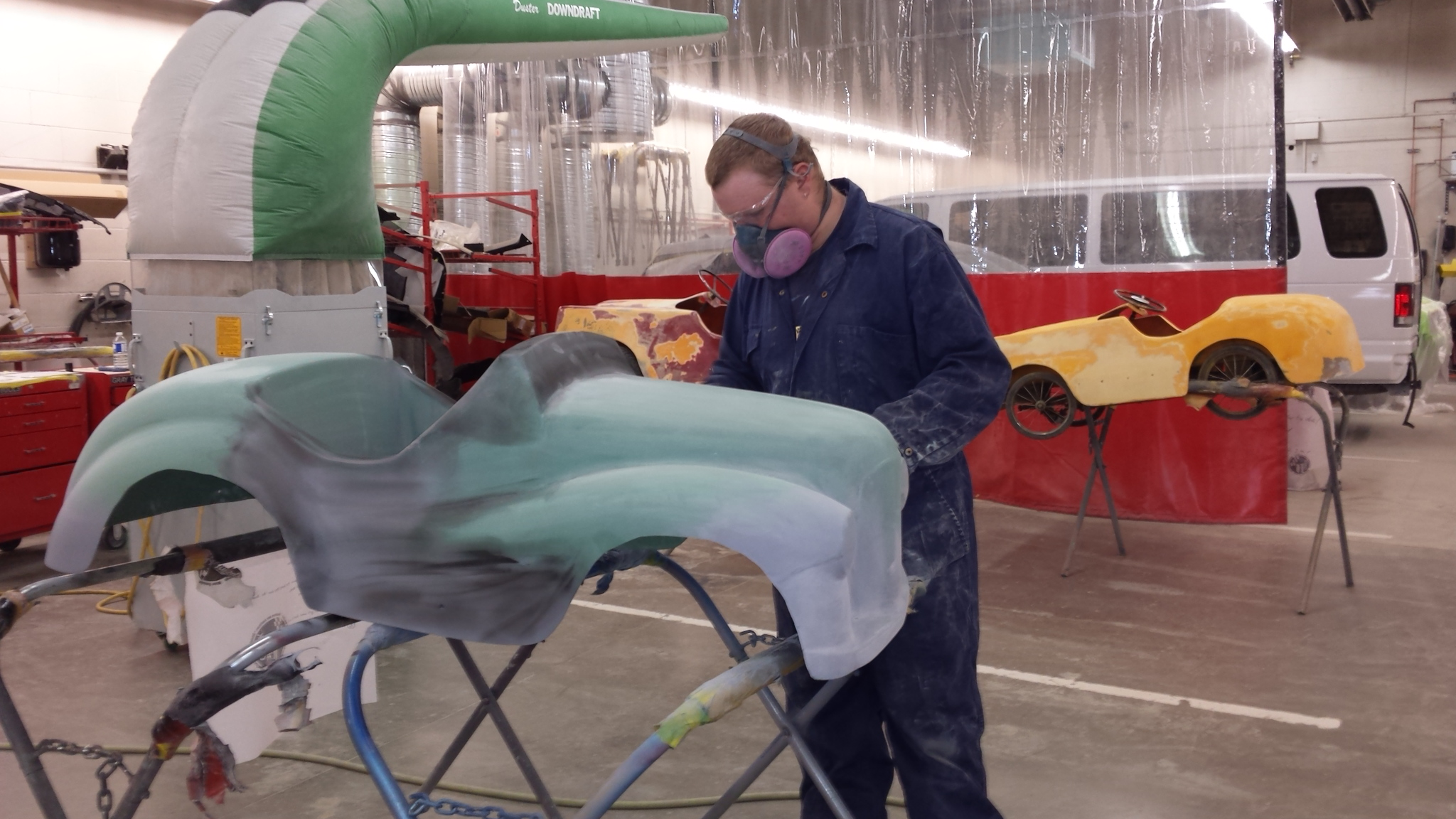 Collision Repair Student taking care in his part of the restoration